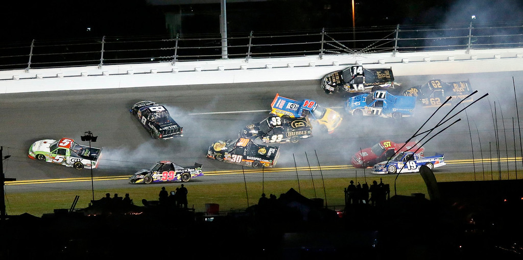 Description of . Trucks crash during the NASCAR Camping World Truck Series NextEra Energy Resources 250 race at the Daytona International Speedway in Daytona Beach, Florida February 22, 2013. The Daytona 500 NASCAR Sprint Cup race is scheduled for February 24.    REUTERS/Pierre Ducharme