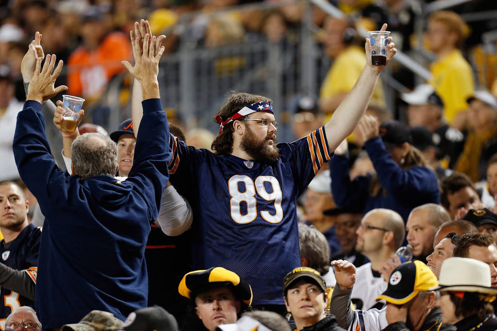 Description of . Chicago Bears fans celebrate a touchdown against the Pittsburgh Steelers at Heinz Field on September 22, 2013 in Pittsburgh, Pennsylvania.  (Photo by Gregory Shamus/Getty Images)