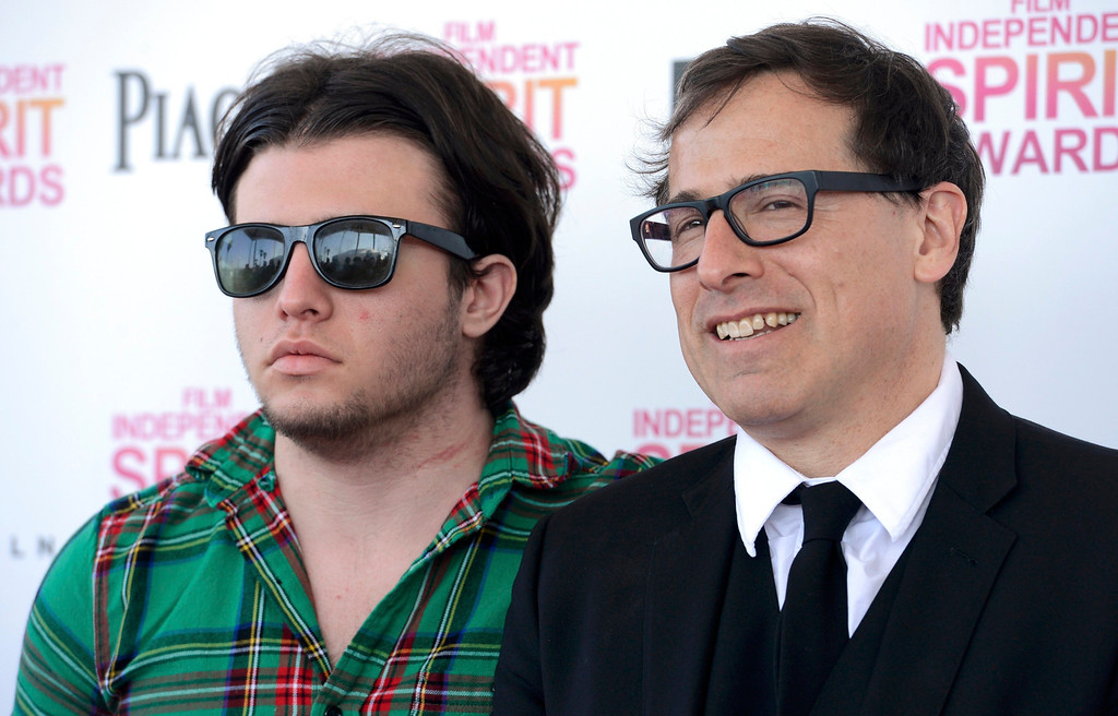 """. Screenwriter David O. Russell (R) talks with his son Matthew Antonio Grillo Russell as they arrive at the 2013 Film Independent Spirit Awards in Santa Monica, California February 23, 2013. Russell won the best screenplay award for \""""Silver Linings Playbook.\""""    REUTERS/Phil McCarten"""