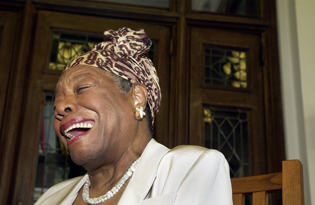 . Maya Angelou laughs at the Abyssian Development Corporation\'s tenth annual Harlem Renaissance Day of Commitment, June 15, 2004 in New York City.  President Bill Clinton was honored at the event, but was unable to attend. (Photo by Scott Eells/Getty Images)