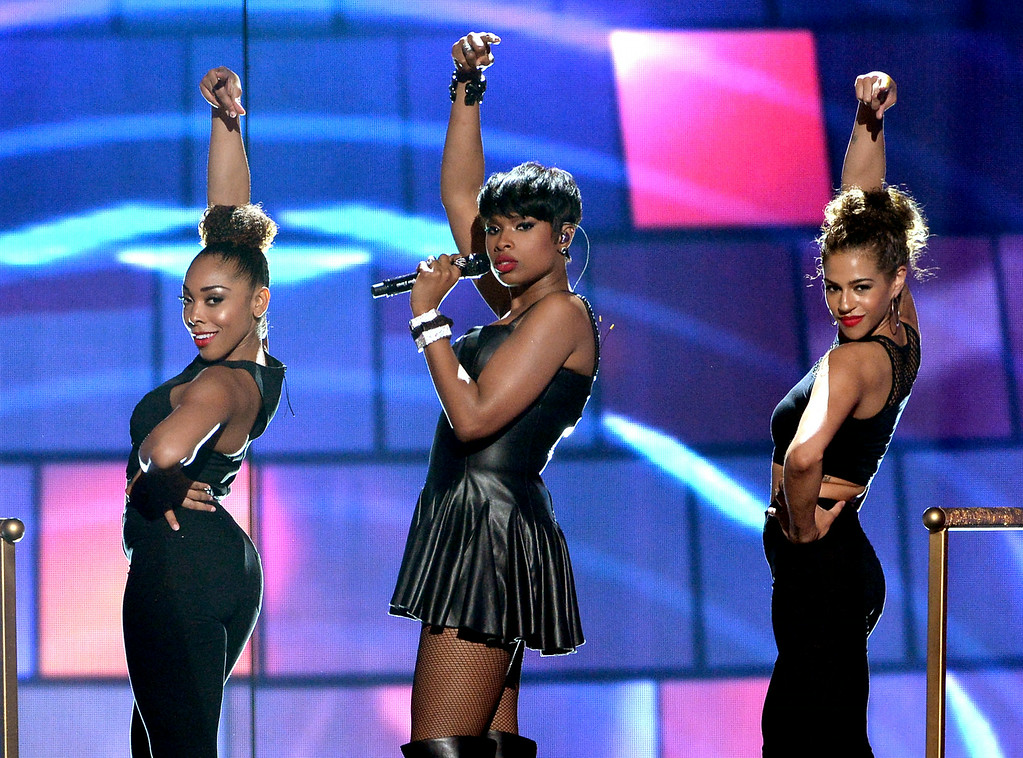 Description of . Singer/actress Jennifer Hudson (C) performs onstage during the BET AWARDS '14 at Nokia Theatre L.A. LIVE on June 29, 2014 in Los Angeles, California.  (Photo by Kevin Winter/Getty Images for BET)