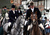 Riders with the Avon Vale Hunt, follow the hounds as they ride out for their traditional Boxing Day hunt, on December 26, 2012 in Lacock, England. As hundreds of hunts met today, Environment Secretary Owen Paterson claimed that moves to repeal the ban on hunting with dogs in England and Wales may not happen in 2013, although he insisted it was still the government's intention to give MPs a free vote on lifting the ban.  (Photo by Matt Cardy/Getty Images)