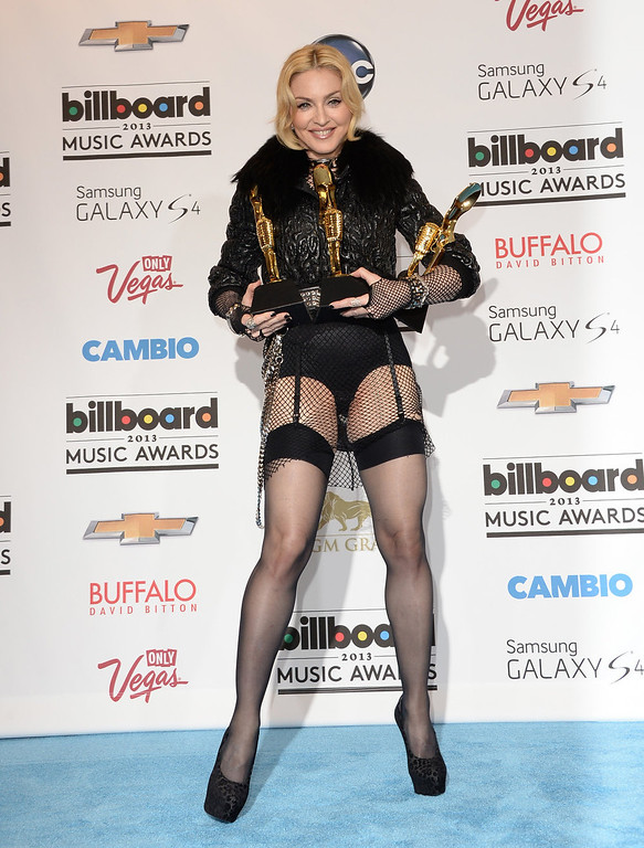 . Madonna poses in the press room with the Top Touring Artist Award during the 2013 Billboard Music Awards at the MGM Grand Garden Arena on May 19, 2013 in Las Vegas, Nevada.  (Photo by Jason Merritt/Getty Images)