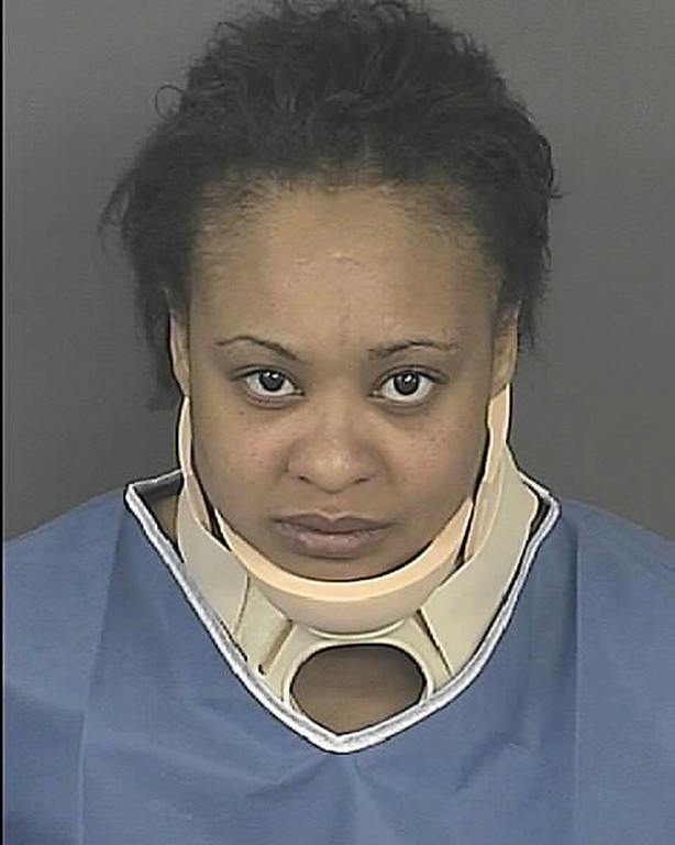 . Latoya Nelson, 29, was arrested on suspicion of vehicular homicide/reckless driving and leaving the scene of an accident involving death. (Provided by the Denver Police Department)