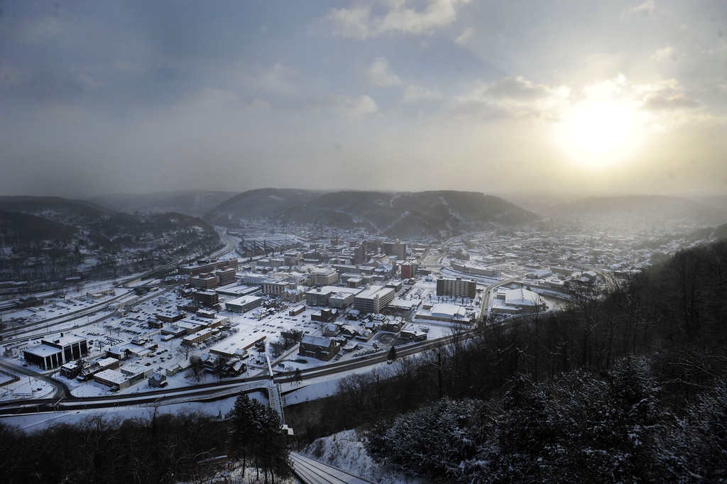 Description of . A cold sun rises over the city of Johnstown, Pa. Tuesday Jan. 7, 2014.  The temperature was at minus 18 degrees at 8 a.m. (AP Photo/The Tribune-Democrat, Todd Berkey)