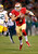 San Francisco 49ers quarterback Colin Kaepernick (7) runs for a 20-yard touchdown against the Green Bay Packers during the first quarter of an NFC divisional playoff NFL football game in San Francisco, Saturday, Jan. 12, 2013. (AP Photo/Tony Avelar)
