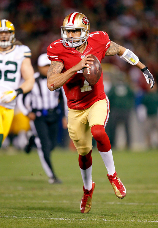 Description of . San Francisco 49ers quarterback Colin Kaepernick (7) runs for a 20-yard touchdown against the Green Bay Packers during the first quarter of an NFC divisional playoff NFL football game in San Francisco, Saturday, Jan. 12, 2013. (AP Photo/Tony Avelar)