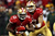 Quarterback Colin Kaepernick #7 of the San Francisco 49ers hands the ball to running back Frank Gore #21 against the Green Bay Packers during the NFC Divisional Playoff Game at Candlestick Park on January 12, 2013 in San Francisco, California.  (Photo by Stephen Dunn/Getty Images)