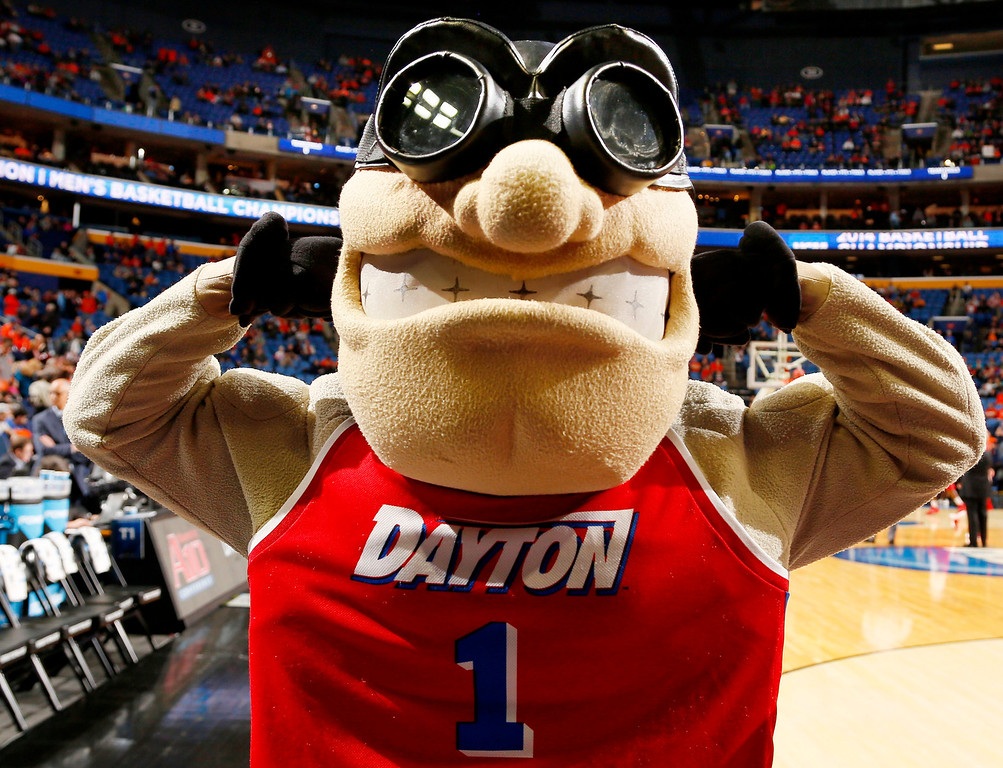 Description of . Dayton's mascot poses for photographs before Dayton's third-round game against Syracuse in the NCAA men's college basketball tournament in Buffalo, N.Y., Saturday, March 22, 2014. (AP Photo/Bill Wippert)