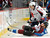 Colorado Avalanche center Ryan O'Reilly (37) is knocked off his skates by Washington Capitals left wing Alex Ovechkin (8) during the first period of an NHL hockey game Saturday, Dec. 17, 2011, in Denver. (AP Photo/Jack Dempsey)