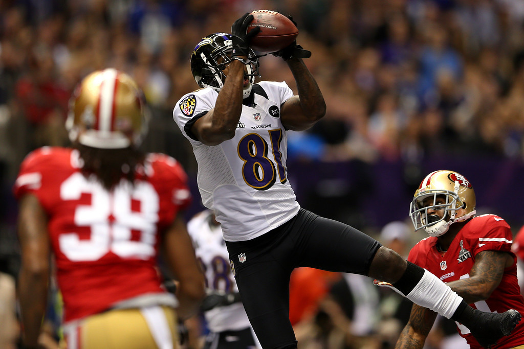 Description of . Anquan Boldin #81 of the Baltimore Ravens catches a touchdown pass in the first quarter over Donte Whitner #31 of the San Francisco 49ers during Super Bowl XLVII at the Mercedes-Benz Superdome on February 3, 2013 in New Orleans, Louisiana.  (Photo by Mike Ehrmann/Getty Images)