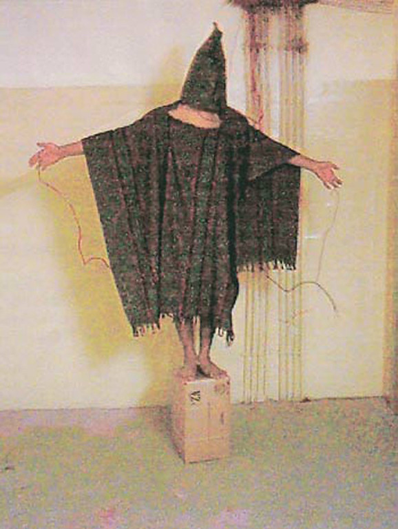 . A hooded and wired Iraqi prisoner is seen at the Abu Ghraib prison near Baghdad, Iraq in this undated photo.  (AP Photo/Courtesy of  The New Yorker)