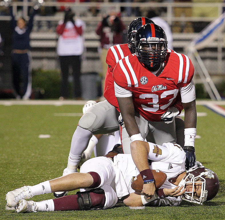 Description of . Ole Miss and Mississippi State battle it out during their rivalry in November, 2012.  (Photo Courtesy of Ole Miss Athletics)