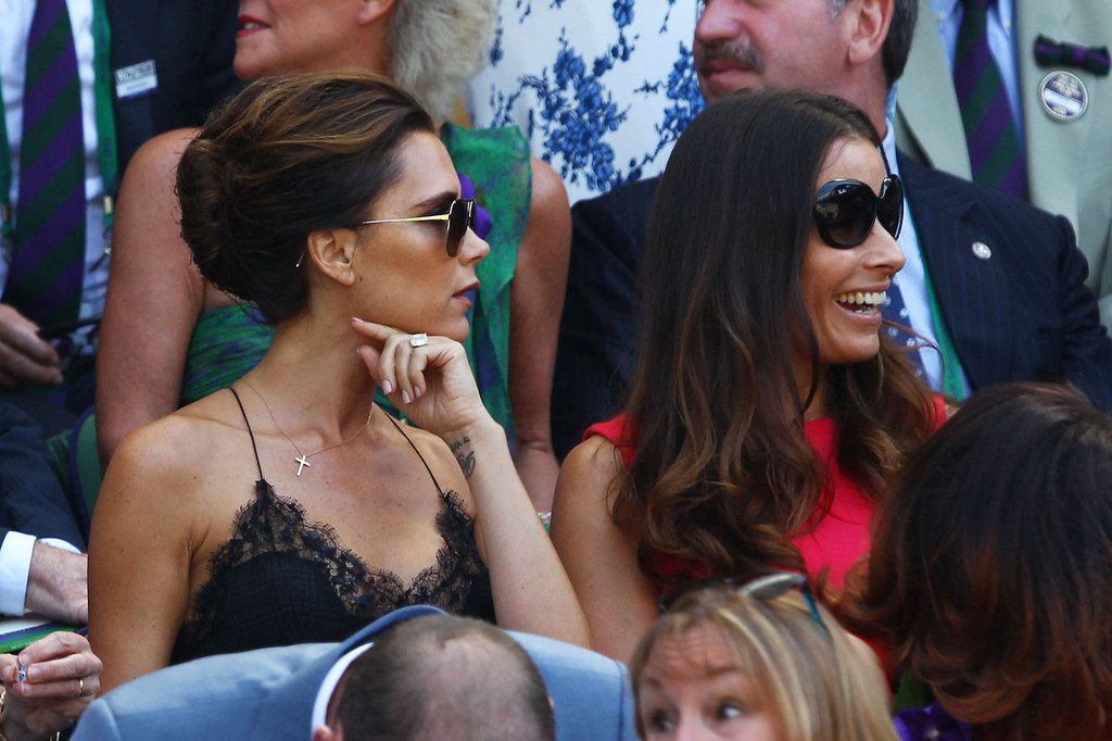 Description of . Victoria Beckham and Tana Ramsey attend the Gentlemen's Singles Final match between Andy Murray of Great Britain and Novak Djokovic of Serbia on day thirteen of the Wimbledon Lawn Tennis Championships at the All England Lawn Tennis and Croquet Club on July 7, 2013 in London, England.  (Photo by Clive Brunskill/Getty Images)