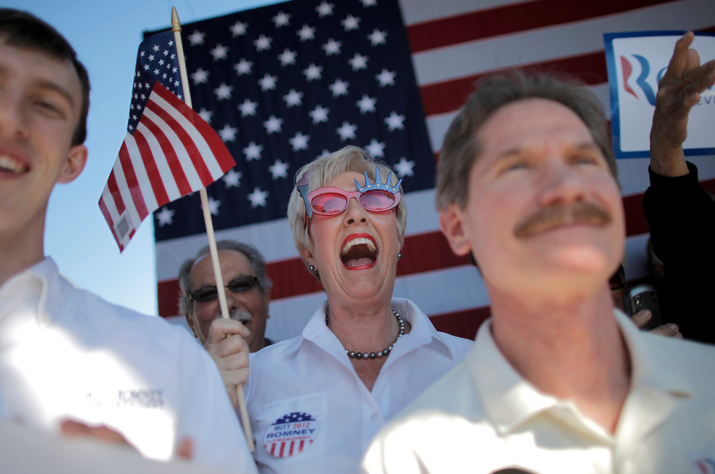 Description of . Jackie Nigro cheers as she waits for Republican presidential candidate, former Massachusetts Gov. Mitt Romney at a campaign stop at Pioneer Park in Dunedin, Fla., Monday, Jan. 30, 2012. (AP Photo/Charles Dharapak)