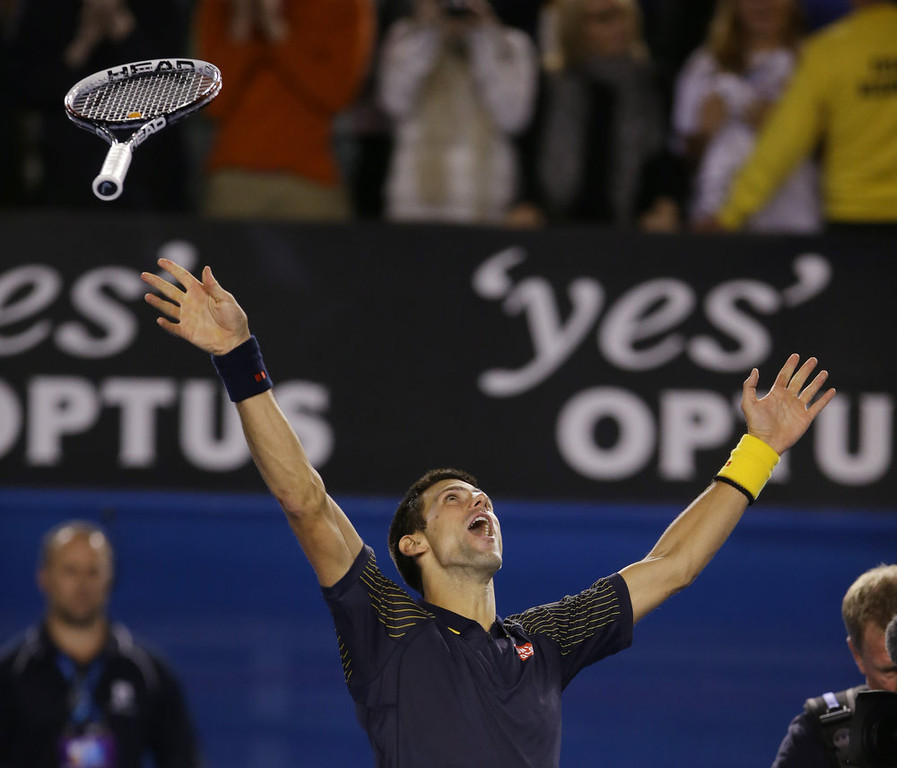 Description of . Serbia\'s Novak Djokovic celebrates his win over Britain\'s Andy Murray in the men\'s final at the Australian Open tennis championship in Melbourne, Australia, Sunday, Jan. 27, 2013. (AP Photo/Dita Alangkara)