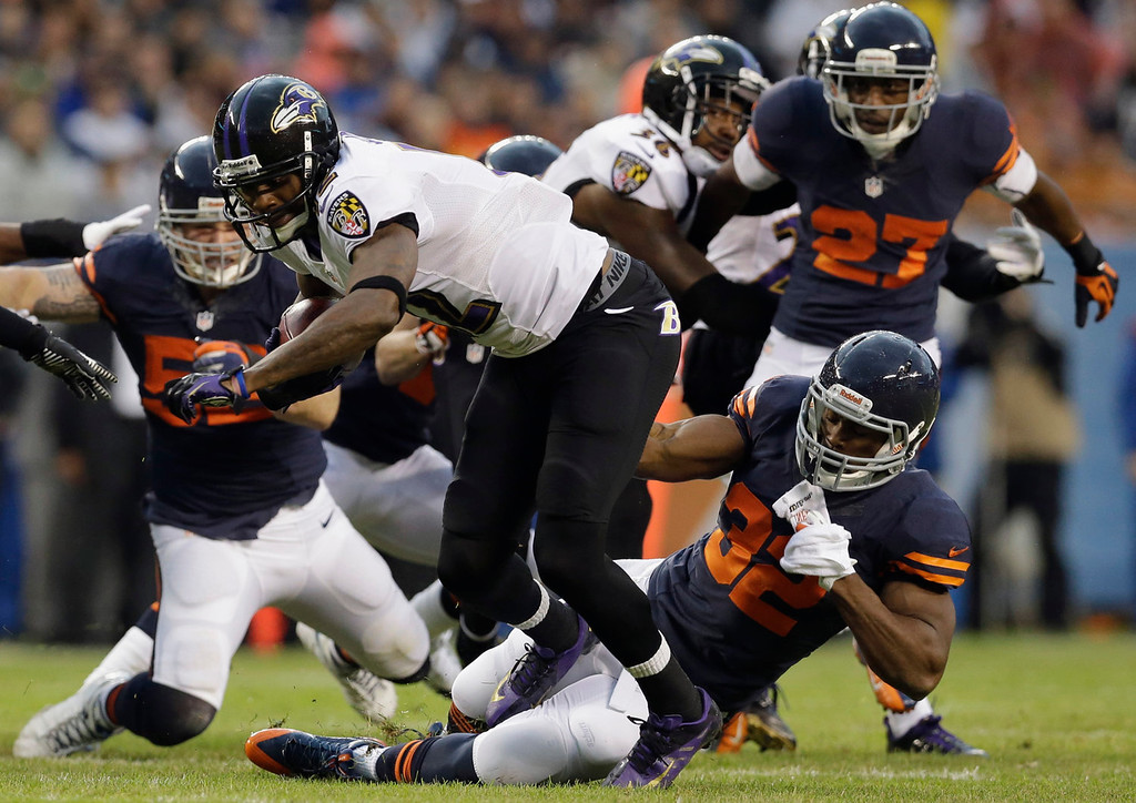 Description of . Baltimore Ravens\' Jacoby Jones is tackled on a punt return by Chicago Bears\' Michael Ford (32) during the first half of an NFL football game, Sunday, Nov. 17, 2013, in Chicago. (AP Photo/Nam Y. Huh)