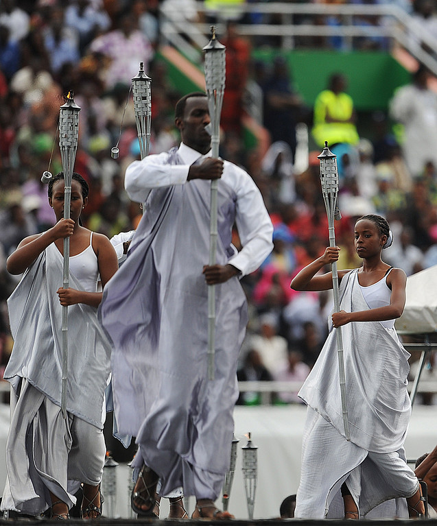 Description of . Performers enter the Amahoro stadium in Kigali on April 7,2014, during a ceremony marking the 20th anniversary of Rwanda's genocide.  AFP PHOTO / SIMON MAINA/AFP/Getty Images
