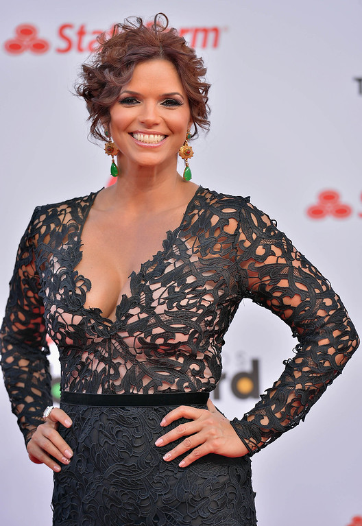 Description of . MIAMI, FL - APRIL 25:  Rashel Diaz arrives at Billboard Latin Music Awards 2013 at Bank United Center on April 25, 2013 in Miami, Florida.  (Photo by Gustavo Caballero/Getty Images)