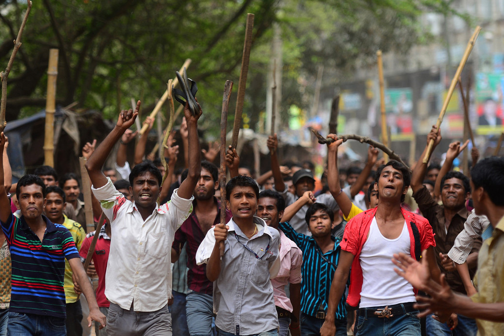 Description of . Bangladeshi people and garments workers march in the street demanding the death sentence for owner of Rana Plaza, Sohel Rana following the eight-story building collapse in Savar, on the outskirts of Dhaka, on April 30, 2013.  AFP PHOTO/MUNIR UZ ZAMAN/AFP/Getty Images