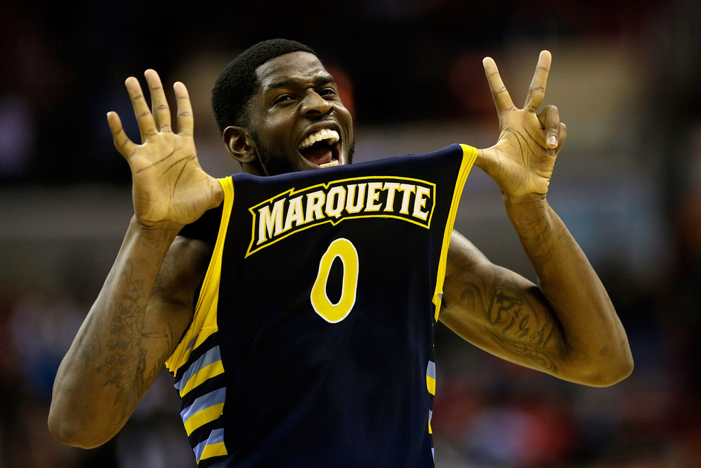 Description of . WASHINGTON, DC - MARCH 28:  Jamil Wilson #0 of the Marquette Golden Eagles reacts after defeating the Miami (Fl) Hurricanes during the East Regional Round of the 2013 NCAA Men's Basketball Tournament at Verizon Center on March 28, 2013 in Washington, DC.  (Photo by Win McNamee/Getty Images)