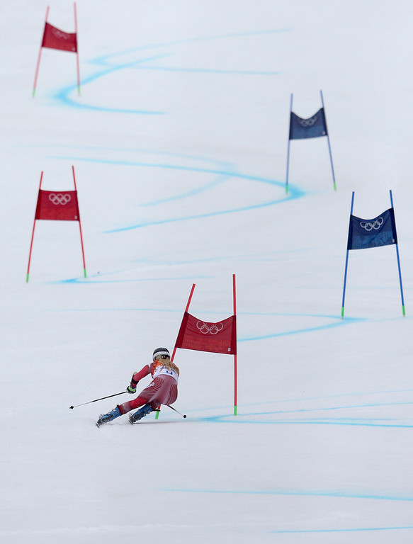Description of . Switzerland's Lara Gut passes a gate in the second run of the women's giant slalom at the Sochi 2014 Winter Olympics, Tuesday, Feb. 18, 2014, in Krasnaya Polyana, Russia.(AP Photo/Alessandro Trovati)