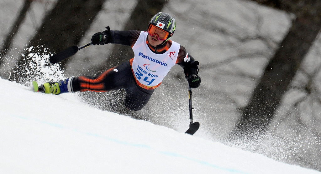 Description of . Hiraku Misawa of Japan competes in the men's Super-G standing race at the Winter Paralympics 2014 Sochi in Krasnaya Polyana, Russia.  EPA/VASSIL DONEV