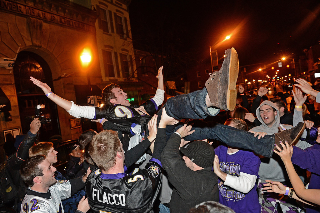 Description of . Baltimore Ravens fans celebrate in the streets after Super Bowl XLVII against the San Francisco 49ers in the neighborhood of Federal Hill on February 3, 2013 in Baltimore, Maryland. The Baltimore Ravens won the Super Bowl, 34-31, to capture their second championship title. (Photo by Patrick Smith/Getty Images)
