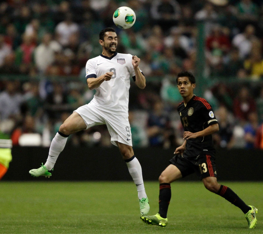 Description of . Herculez Gomez (L) of the U.S heads the ball over Severo Meza of Mexico during their 2014 World Cup qualifying soccer match at Azteca stadium in Mexico City March 26, 2013. REUTERS/Henry Romero