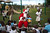 A man disguised as Santa Claus poses for pictures with a boy during a Christmas gift distribution at the U.S. Embassy in Port-au-Prince, Haiti, Sunday Dec. 23, 2012. (AP Photo/Dieu Nalio Chery)