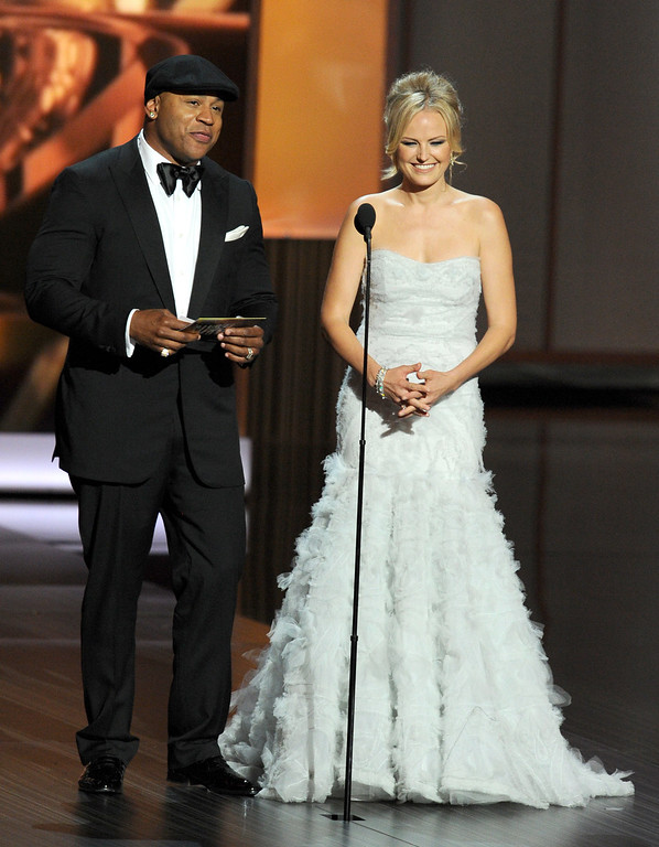 Description of . Presenters LL Cool J and Malin Akerman speak onstage during the 65th Annual Primetime Emmy Awards held at Nokia Theatre L.A. Live on September 22, 2013 in Los Angeles, California.  (Photo by Kevin Winter/Getty Images)