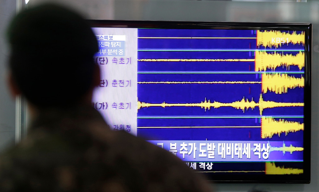 Description of . A South Korean soldier watches a TV screen reporting seismic waves of North Korea's nuclear test at Seoul train station in Seoul, South Korea, Tuesday, Feb. 12, 2013.  Defying U.N. warnings, North Korea on Tuesday conducted an underground nuclear test in the remote, snowy northeast, taking a crucial step toward its goal of building a bomb small enough to be fitted on a missile capable of striking the United States. (AP Photo/Lee Jin-man)