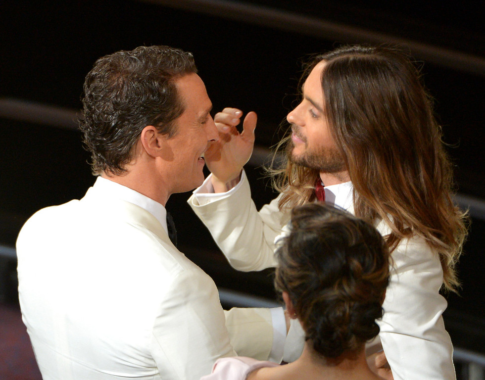 Description of . Matthew McConaughey, left, congratulates Jared Leto in the audience during the Oscars at the Dolby Theatre on Sunday, March 2, 2014, in Los Angeles.  (Photo by John Shearer/Invision/AP)