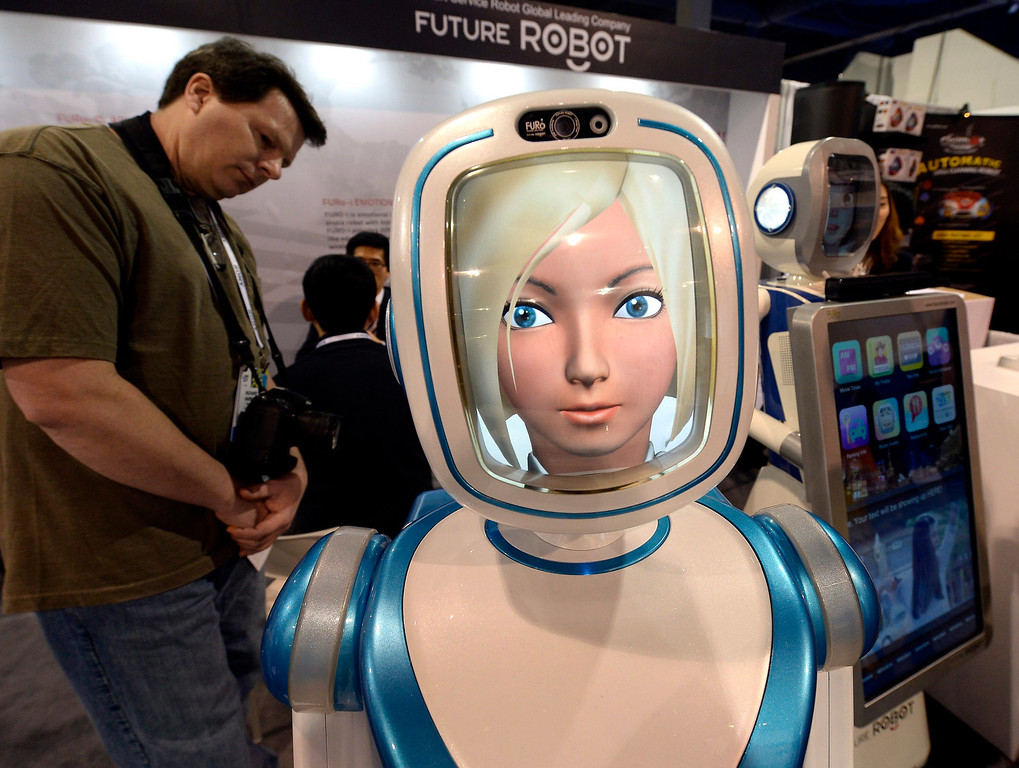 Description of . An attendee examines the Future Robot, a 24-hour, 365 day user-friendly service human-robot with emotional interaction multifunctional intelligent service robot at the Las Vegas Convention Center for the 2014 International CES (Consumer Electronics Show) in Las Vegas, Nevada, USA, 08 January 2014. CES, the world's largest annual consumer technology trade show, runs from 7-10 January and is expected to feature 3,200 exhibitors displaying their latest products and services to about 150,000 attendees.  EPA/MICHAEL NELSON
