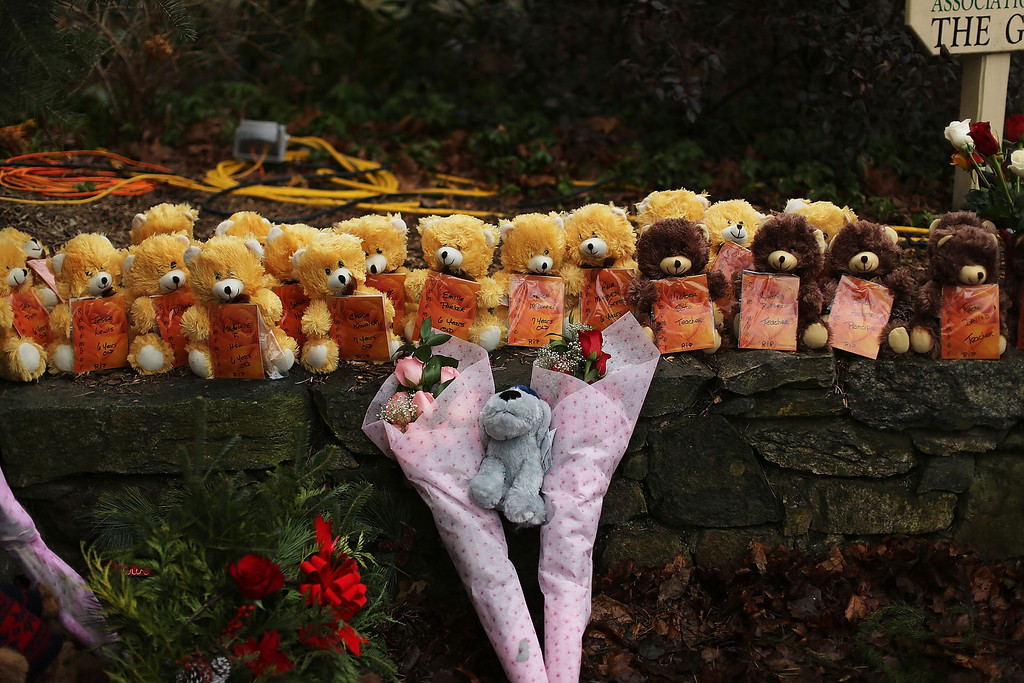Description of . NEWTOWN, CT - DECEMBER 16: Teddy bears and flowers, in memory of those killed, are left at a memorial down the street from the Sandy Hook School December 16, 2012 in Newtown, Connecticut. Twenty-six people were shot dead, including twenty children, after a gunman identified as Adam Lanza opened fire at Sandy Hook Elementary School. Lanza also reportedly had committed suicide at the scene. A 28th person, believed to be Nancy Lanza, found dead in a house in town, was also believed to have been shot by Adam Lanza.  (Photo by Spencer Platt/Getty Images)
