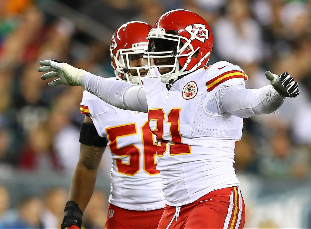 Description of . Tamba Hali #91 of the Kansas City Chiefs celebrates after sacking Michael Vick of the Philadelphia Eagles in the second quarter at Lincoln Financial Field on September 19, 2013 in Philadelphia, Pennsylvania.  (Photo by Elsa/Getty Images)