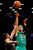 Boston Celtics' Courtney Lee (11) shoots over Brooklyn Nets guard Joe Johnson (7) in the second half of their NBA basketball game at Barclays Center, Tuesday, Dec. 25, 2012, in New York. Boston won 93-76. (AP Photo/John Minchillo)