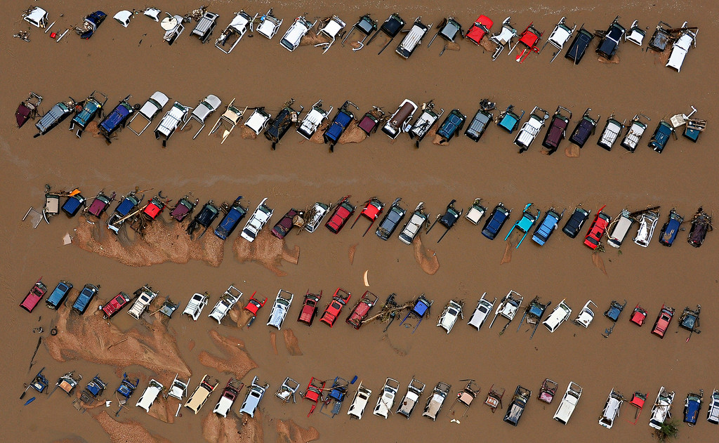 Description of . A junkyard on East 37th Street and First Avenue in Evans, Colo., sits in rising floodwater from the South Platte River.