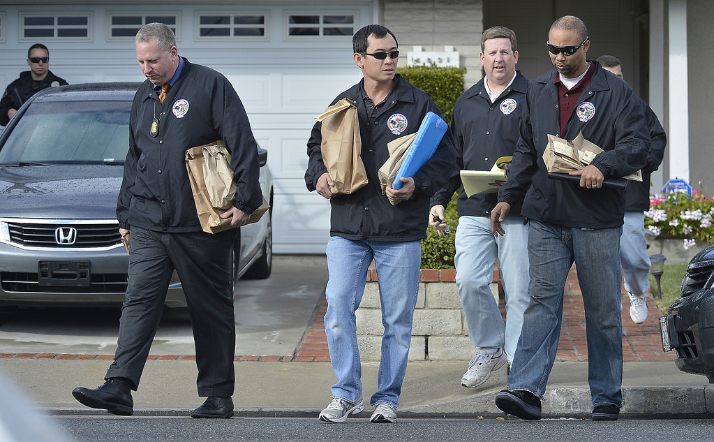 Description of . LA PALMA, CALIF. -- Members of the Orange County Regional Computer Forensics Lab leave the home of the mother of alleged triple-murderer  Christopher Dorner in La Palma, California on February 8, 2013. Photo by Jeff Gritchen / Los Angeles Newspaper Group