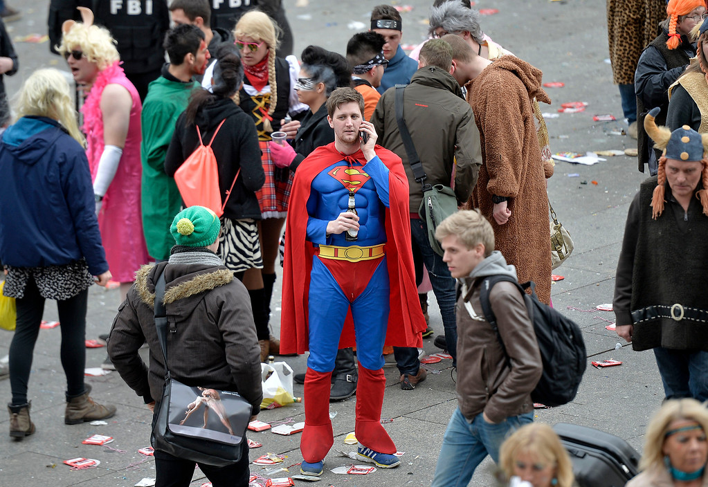 "Description of . A man in a superman costume talks on his cellphone when tens of thousands of revelers dressed in carnival costumes celebrate the start of the street-carnival on the so called ""Old Women\'s Day\"" in the party capital Cologne, Germany, Thursday, Feb. 27, 2014. (AP Photo/Martin Meissner)"