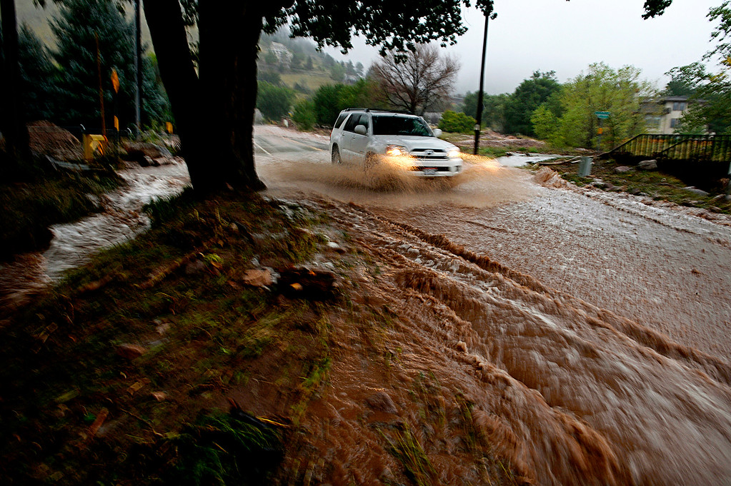 Description of . BOULDER, CO. - SEPTEMBER12:  Water rushes down Linden Ave in Boulder Colo. on September 12, 2013. Record-breaking rain turned normally quiet creeks into raging, brown torrents that swept through Boulder on Thursday, flooding homes, swamping cars and closing roads and schools. (Photo By Craig F. Walker / The Denver Post)
