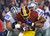 Washington Redskins running back Alfred Morris is tackled by Dallas Cowboys nose tackle Sean Lissemore (95) and defensive end Jason Hatcher (97) during the first half of an NFL football game Sunday, Dec. 30, 2012, in Landover, Md. (AP Photo/Alex Brandon)