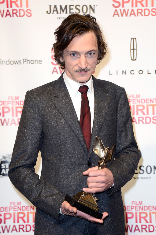 . SANTA MONICA, CA - FEBRUARY 23:  Actor John Hawkes poses with the Best Male Lead award for \'The Sessions\' in the press room during the 2013 Film Independent Spirit Awards at Santa Monica Beach on February 23, 2013 in Santa Monica, California.  (Photo by Frazer Harrison/Getty Images)