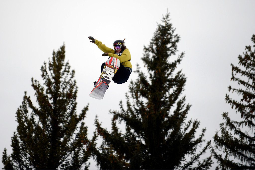 Description of . ASPEN, CO. - JANUARY 26:  Spencer O'Brien get's air during the women's snowboard slopestyle finals at the 2013 Aspen X Games on Buttermilk Mountain on January 26, 2013. (Photo By Mahala Gaylord / The Denver Post)