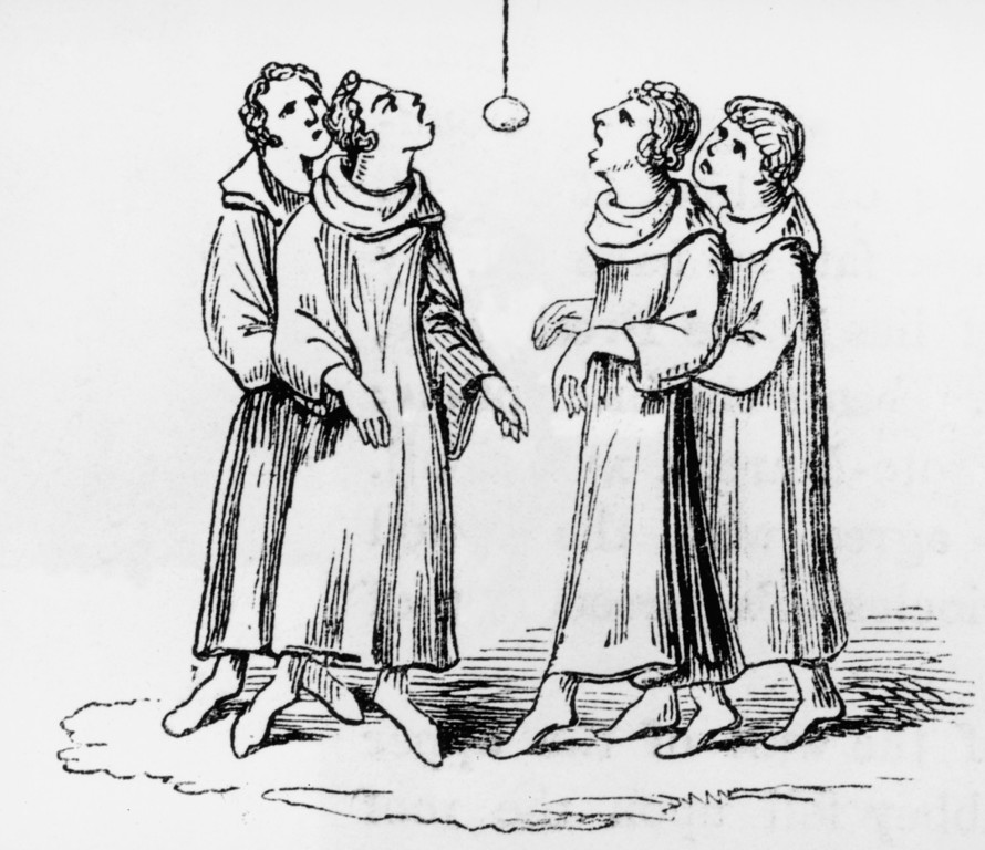 Description of . A group of men playing 'bob apple' at halloween, circa 1500. (Photo by Hulton Archive/Getty Images)