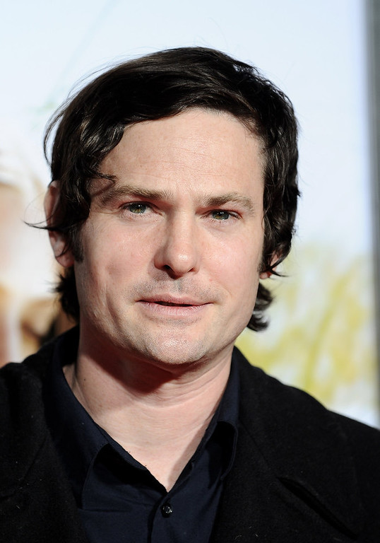 "Description of . Actor Henry Thomas arrives at the premiere of Screen Gems\' ""Dear John\"" at the Grauman\'s Chinese Theatre on February 1, 2010 in Hollywood, California.  (Photo by Michael Buckner/Getty Images)"