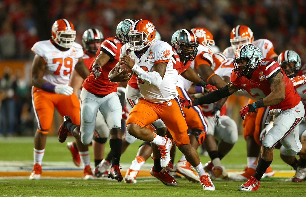 Description of . MIAMI GARDENS, FL - JANUARY 03:  Tajh Boyd #10 of the Clemson Tigers runs for a touchdown in the first half against the Ohio State Buckeyes during the Discover Orange Bowl at Sun Life Stadium on January 3, 2014 in Miami Gardens, Florida.  (Photo by Streeter Lecka/Getty Images)