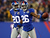 Antrel Rolle #26 of the New York Giants celebrates after he recovered a New Orleans Saints fumble with teamamte Prince Amukamara #20 on December 9, 2012 at MetLife Stadium in East Rutherford, New Jersey.  (Photo by Elsa/Getty Images)
