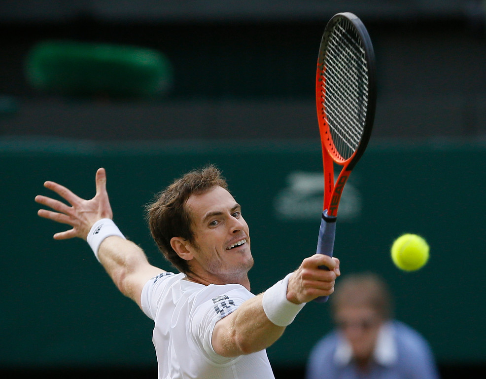 Description of . Andy Murray of Britain plays a return to Jerzy Janowicz of Poland during their Men\'s singles semifinal match at the All England Lawn Tennis Championships in Wimbledon, London, Friday, July 5, 2013. (AP Photo/Kirsty Wigglesworth)