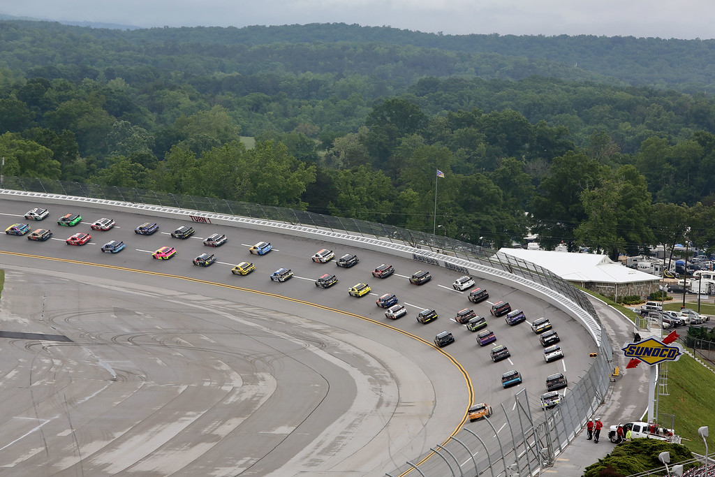 Description of . TALLADEGA, AL - MAY 04:  A pack of cars drive through a turn during the NASCAR Nationwide Series Aaron's 312 at Talladega Superspeedway on May 4, 2013 in Talladega, Alabama.  (Photo by Jerry Markland/Getty Images)